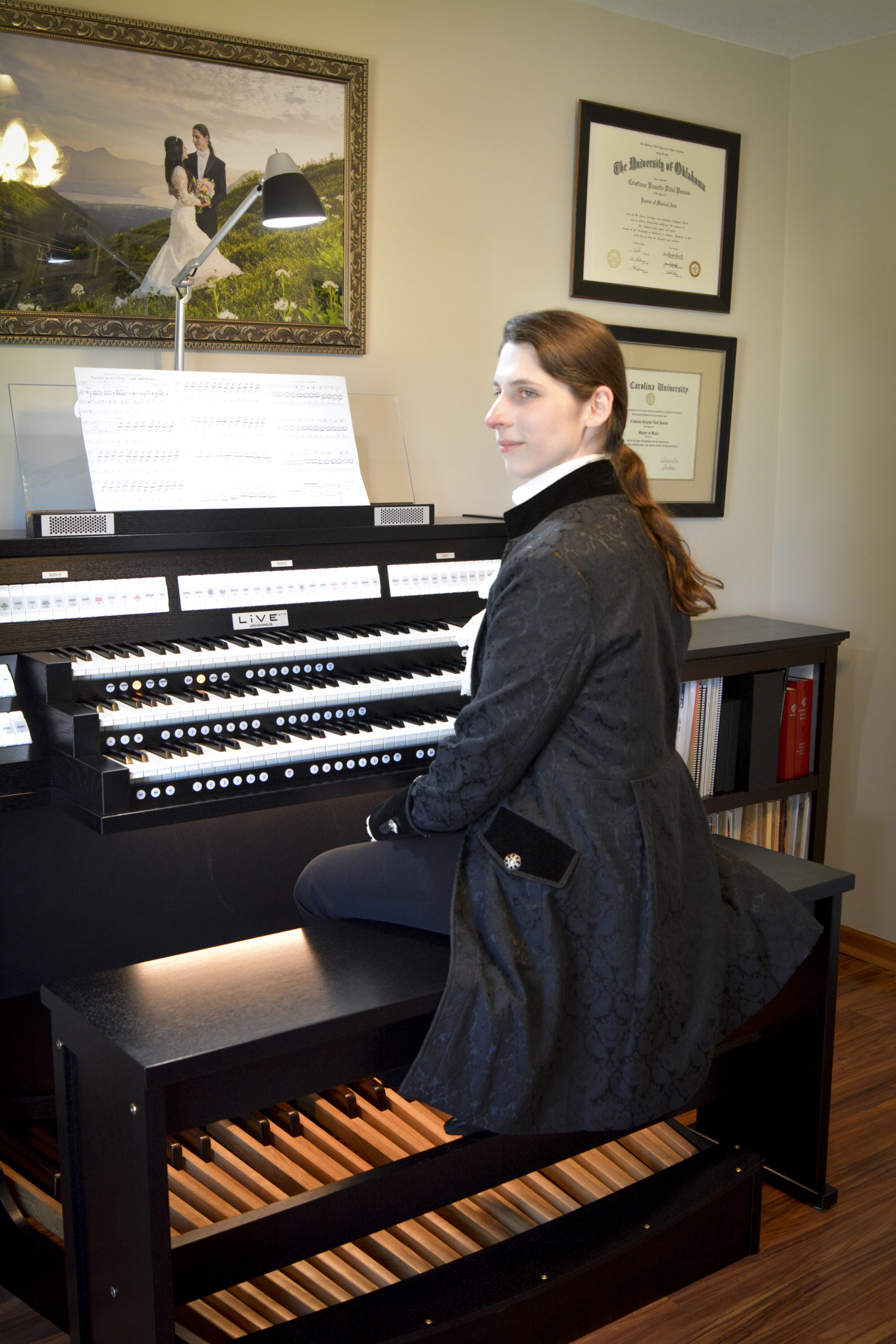 Latvian Brazilian transgender organist and composer Dr. Kris Rizzotto at their home organ
