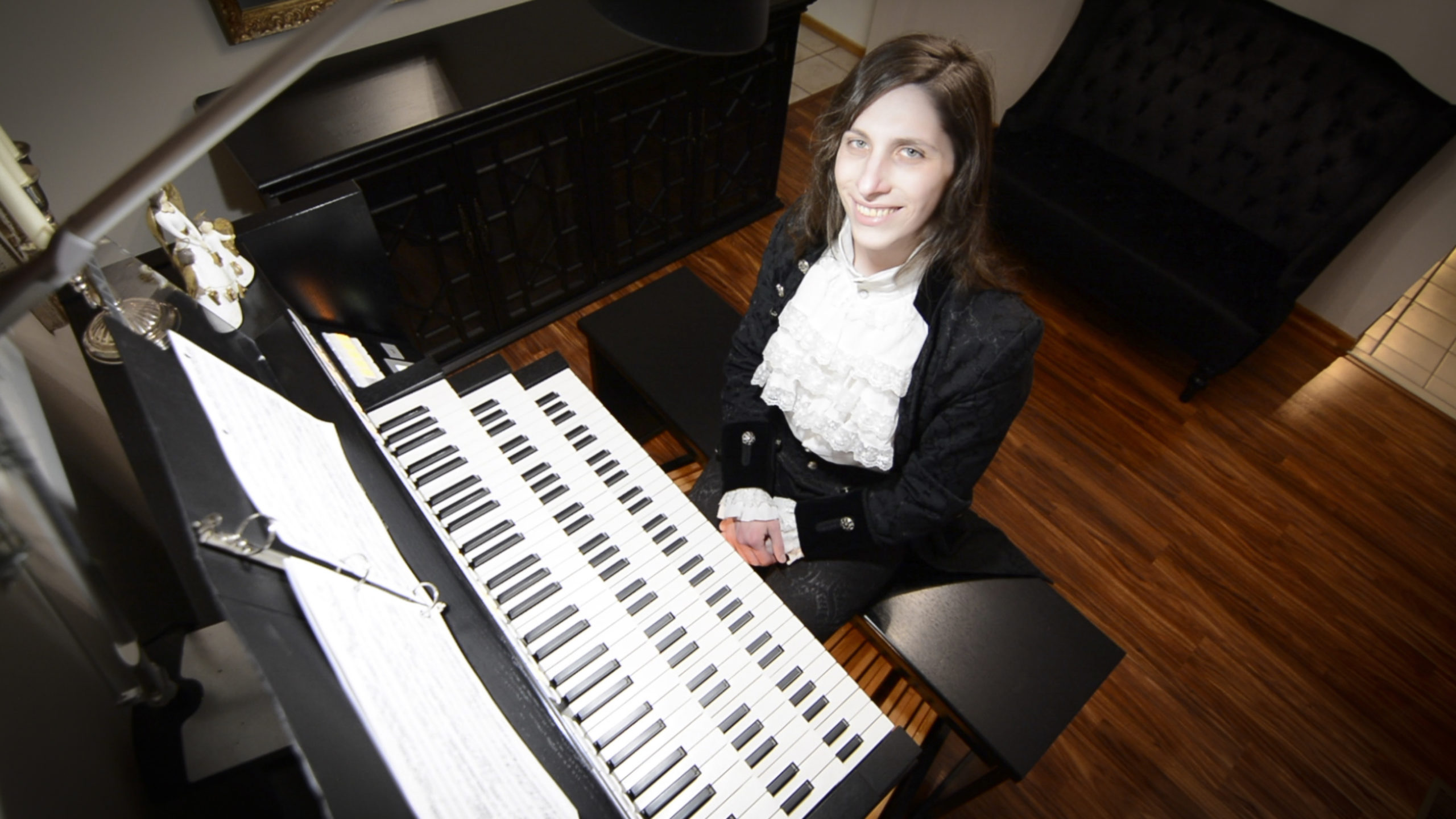 Transgender organist and composer Dr. Kris Rizzotto at the organ