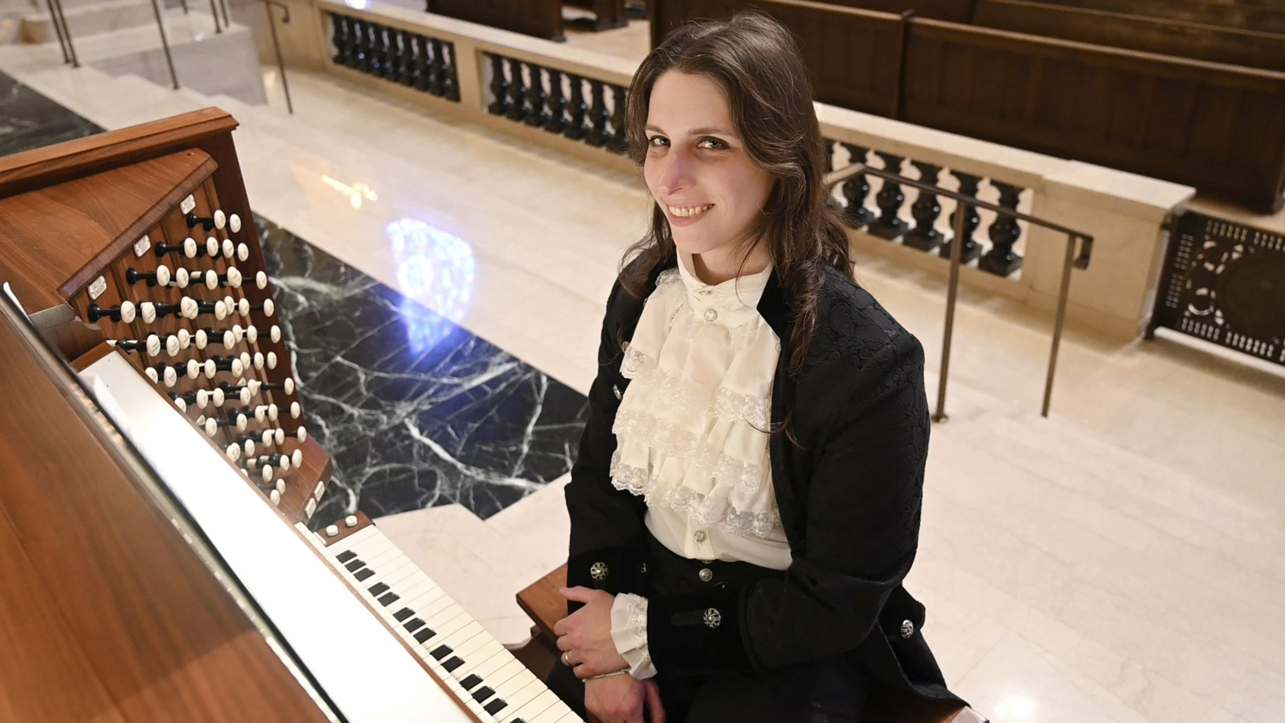 Dr. Kris Rizzotto at the organ transgender organist composer pianist